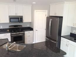 white kitchen cabinets with black slate appliances 10 white cabinets slate appliances ideas slate appliances