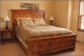 country varnished reclaimed wood flat bed frame with low headboard
