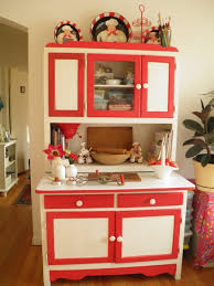 red and white hoosier kitchen cabinet the link has its story and