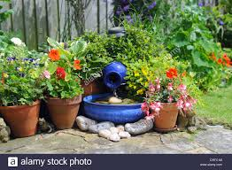 garden solar powered water feature with stone inscribed with love
