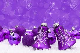 purple christmas balls on a snow and purple background christmas