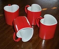 heart shaped mugs interlocking heart mugs on the hunt