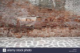 dark room with tile floor and brick wall background stock photo