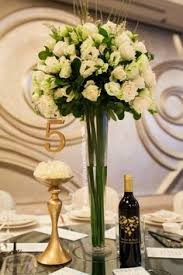 White Rose Centerpieces For Weddings by Wedding Ballroom With Simple White Roses And Green Highlights