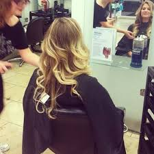 sarah jayne dunn having her hair styled in the arndale store
