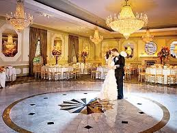 affordable wedding venues in nj chandeliers sparkle above marble floors in their
