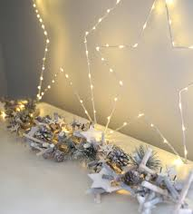 whitewashed and spruce light garland by lilly