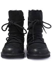 womens ugg lodge boot lyst ugg black sheepskin and suede lodge boot in black