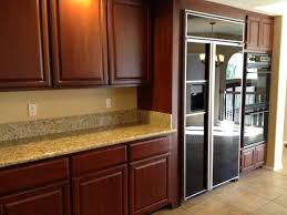 granite countertop stylish kitchen cabinets copper backsplash