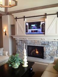 tv above the fireplace with miniature small barn doors