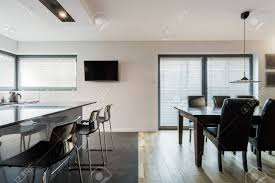 kitchen open to dining room modern open kitchen and dining room with long table stock photo