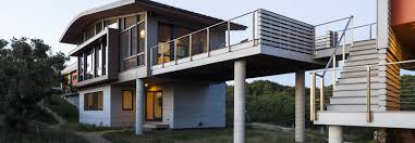low impact cape cod house is designed to provide all its energy on