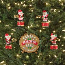the coordinated caroling santa band ornament hammacher schlemmer