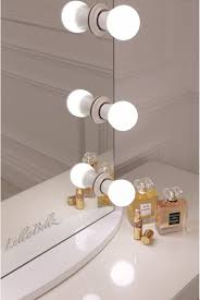 makeup vanity with light bulbs simplistic crisp white finish embedded hollywood light up mirror