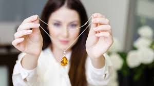 woman with necklace images Self purchasing customers down on traditional jewelry stores jpg