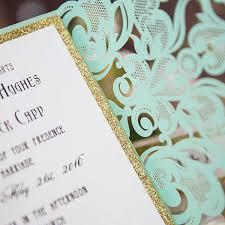 mint green laser cut wedding invitations with glittery bottom