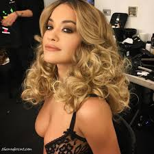 singer actress rita ora curly hairstyles with from instagram