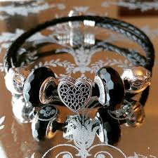 pandora black bracelet with charms images The pandora filled with romance charm pandoratexas jpg