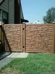 six foot desert sand color vinyl stone fence and gate installed