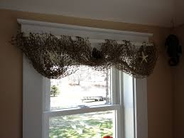i took fishing net and used it as a curtain once i hung it i put