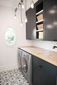 bathroom grey cabinet and subway tile backsplash with window