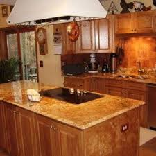 oak kitchen cabinets with painted black hood and cabinet with