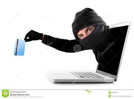 cyber criminal out of computer grabbing and stealing credit card