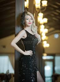 young beautiful luxurious woman in long elegant black dress