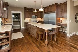 what color flooring goes with alder cabinets portfolio homes knotty alder cabinets home kitchen