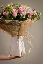 paper wrapped flowers about flower bouquets regal flower designregal flower design