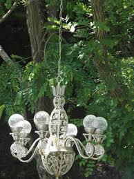 solar powered chandelier in my garden i like the balls