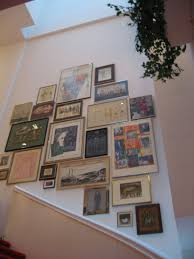 how high should pictures be hung on wall ideas about hanging
