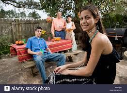 a mexican american family enjoying a backyard picnic stock photo