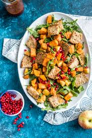 roasted autumn panzanella salad with spiced pomegranate vinaigrette