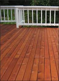 a grey solid color stain on this deck looks great with the white