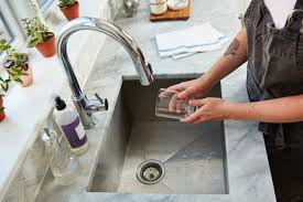 Cleaning Kitchen Sink by How To Clean Your Kitchen Sink Kitchn