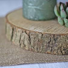 wooden tree slice wedding centrepiece or cake stand by the wedding