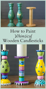 whimsical home decor painting wooden candlesticks turning a thrift store buy into