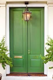 beautiful house exterior design features green front door and