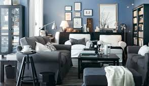 interior dazzling blue living room design with grey sofas and