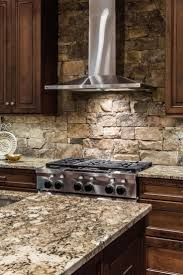 best 25 kitchen granite countertops ideas on pinterest gray and a stainless steel range hood is a sleek contemporary counterpoint to the stacked stone backsplash