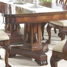 11 piece dining set with double pedestal table and ball u0026 claw