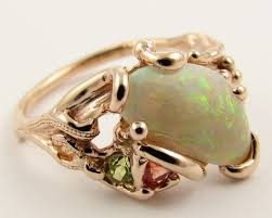 Opal Wedding Ring Sets by Garden Opal Ring Accented By One Round Orange Sapphire And One