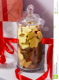 gingerbread cookies in a jar and christmas gifts stock photo