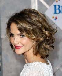 medium length layered hairstyles for curly hair medium length layered hairstyles curly hair