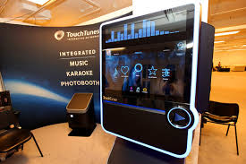 digital photo booth touchtunes interactive network s virtuo machine serves three