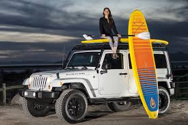 jeep with surfboard retro glide paddleboards