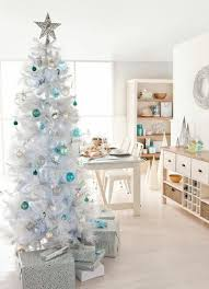 white tree with blue decorations happy holidays