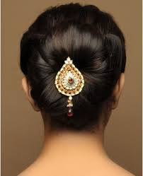 hairpiece stlye for matric flower petal style bun up do with center detail piece wedding