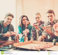 multi ethnic friends celebrating in home interior stock image